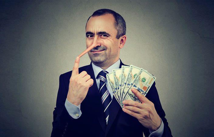 financial-fraud-concept-liar-businessman-with-dollar-cash