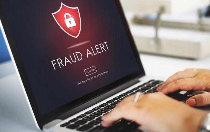 laptop-computer-shows-fraud-alert